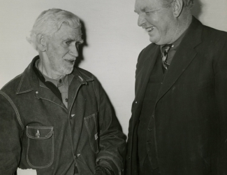 Mr. John Robert Hull and Sergeant Alvin C. York conversing