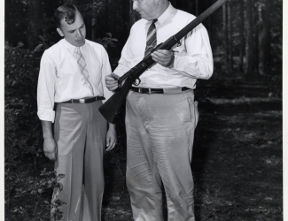 Alvin C. York as Chairman of Fentress County Draft Board showing weapon to local registrant
